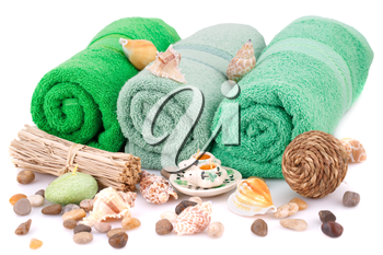 Spa set with towels, candles, shells and stones isolated on white background.