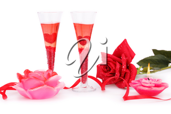 Two glasses, candles and roses  isolated on white background.