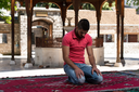 Muslim Man Is Praying In The Mosque Outdoors