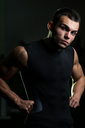 A Muscular Male Model Staring Confidently