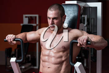 Male Bodybuilder Doing Heavy Weight Exercise For Chest