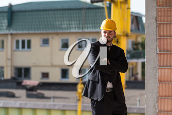 Portrait Of Business Man With Yellow Helmet On Construction