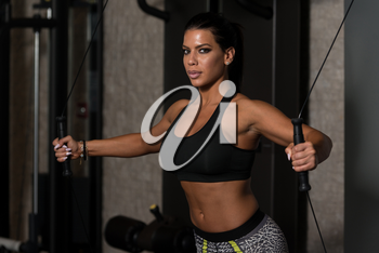 Young Woman Is Working On Her Chest With Cable Crossover In A Modern Gym
