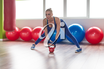Healthy Woman Working With Kettle Bell In A Gym - Kettle-bell Exercise