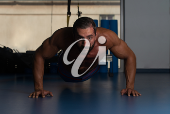 Italian Adult Athlete Doing Push Ups As Part Of Bodybuilding Training With Trx Fitness Straps