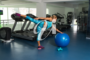 Mature Woman Exercising On Ball In The Gym And Flexing Muscles - Muscular Athletic Bodybuilder Fitness Model