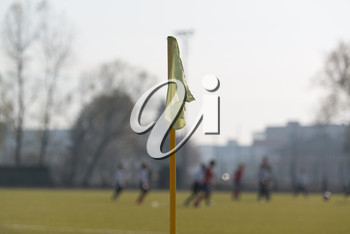 Sport and Game Concept - Close Up of Football Field Corner With Flag Marker