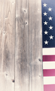USA faded flag border on vertical rustic wooden boards. Vintage effect applied to image.