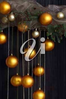 Christmas Balls and Spruce Branches with Cones on Natural Vertical Background.