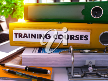 Yellow Office Folder with Inscription Training Courses on Office Desktop with Office Supplies and Modern Laptop. Training Courses Business Concept on Blurred Background. 3D Render.