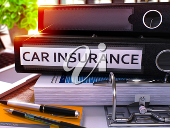 Black Ring Binder with Inscription Car Insurance on Background of Working Table with Office Supplies and Laptop. Car Insurance Business Concept on Blurred Background. 3D Render.