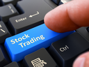 Computer User Presses Blue Button Stock Trading on Black Keyboard. Closeup View. Blurred Background. 3D Render.