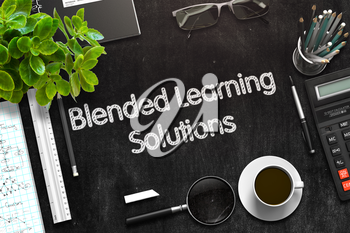 Blended Learning Solutions Handwritten on Black Chalkboard. Top View of Black Office Desk with a Lot of Business and Office Supplies on It. 3d Rendering. Toned Illustration.