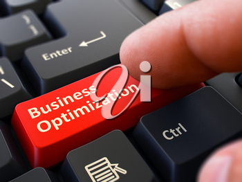 Business Optimization - Written on Red Keyboard Key. Male Hand Presses Button on Black PC Keyboard. Closeup View. Blurred Background.