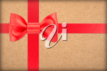 red bow and ribbon over wrapped gift