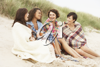 Group Of Girls Sitting On Beach Together