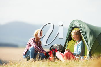 Two Teenage Girls On Camping Trip In Countryside