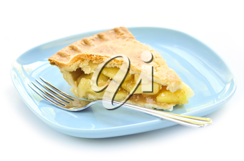 Slice of fresh apple pie on a plate isolated on white background