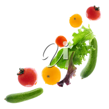 Assorted fresh vegetables flying isolated on white background