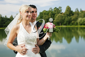 wedding couple looking forward into a bright future