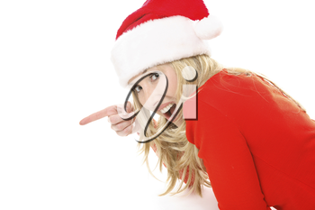 A surprised or delighted female wearing a festive santa hat points to your Christmas message, slogan or product.