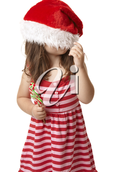 Christmas child playing with santa hat
