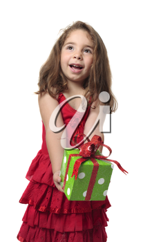 Young happy child holding a present with gleeful smile