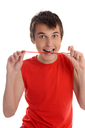 A smiling boy eating jelly candy. White background.