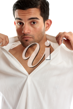 Handsome masculine man removing or putting on a shirt.  White background.
