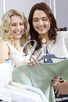 Image of pretty girls chosing clothes in the department store