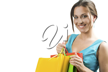 Happy female with shopping bags looking at camera and smiling