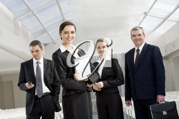 Portrait of smart business people looking at camera and smiling