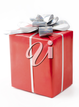 Isolated gift in red decorative box bound with silver ribbon and bow on its top