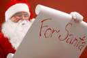 Portrait of Santa Claus reading big letter attentively
