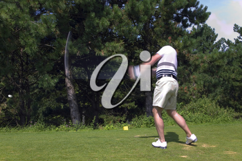 Golfer taking a tee shot with motion blur