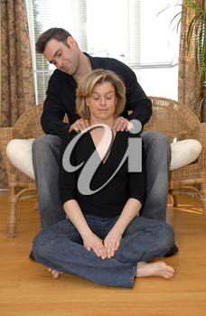 man giving a massasge on the shoulders to his wife