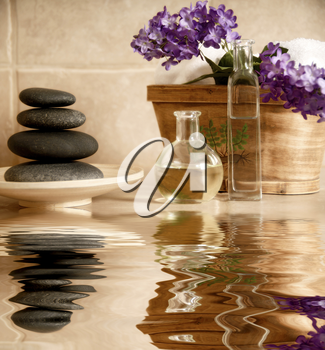 day spa products with stones, oil container, flowers