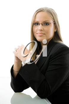 Young happy businesswoman sitting at office desk, smiling. Isolated on white background.