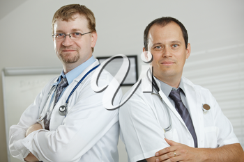 Medical office - doctors posing for team photo.