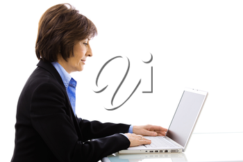 Profile portrait of senior businesswoman using laptop computer, looking at screen. Isolated on white background.