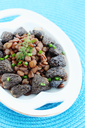 Lentil stew with morel mushrooms and onions