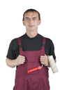 Royalty Free Photo of a House Painter With a Roller