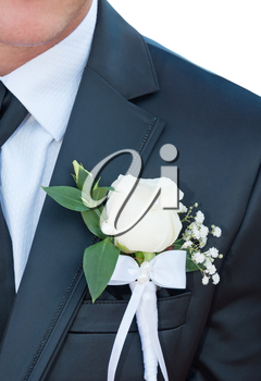 Groomsmen in black wedding suits wearing rose boutonnieres, close-up.