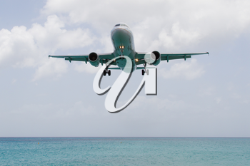Airplane landing on the Caribbean isle of Saint Martin