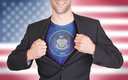 Businessman opening suit to reveal shirt with state flag (USA), Utah
