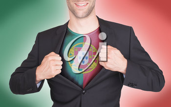 Businessman opening suit to reveal shirt with flag, Portugal