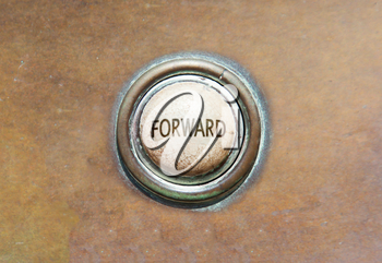 Grunge image of an old button - forward