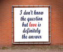 Large banner with inspirational quote on a brick wall - I don't know the question...