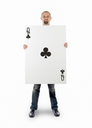 Businessman with large playing card - Queen of clubs