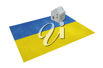 Small house on a flag - Living or migrating to Ukraine